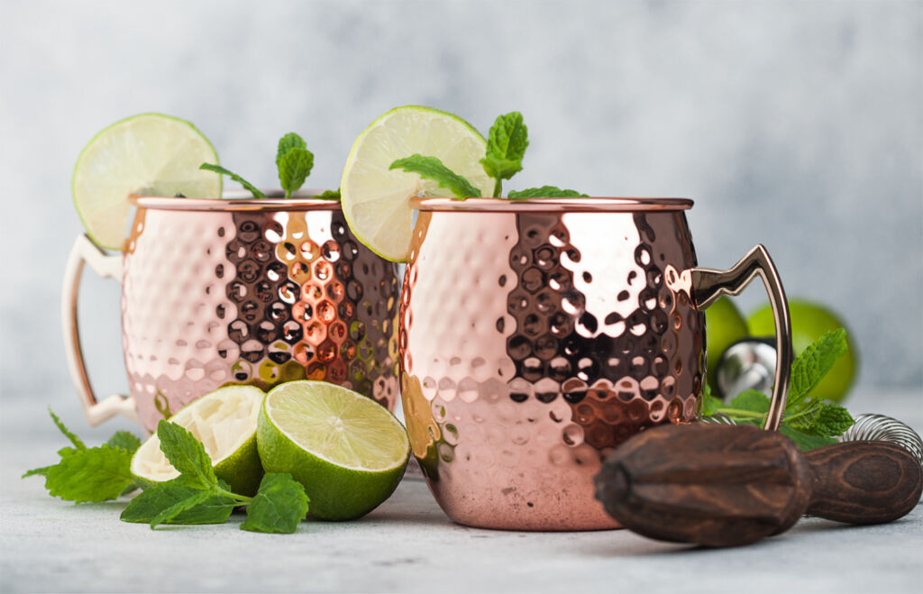 Gin served in copper cups with a slice of lemon