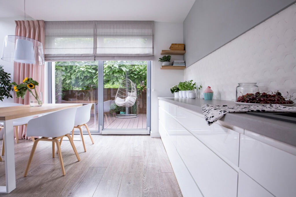 A modern kitchen with grey patio windows