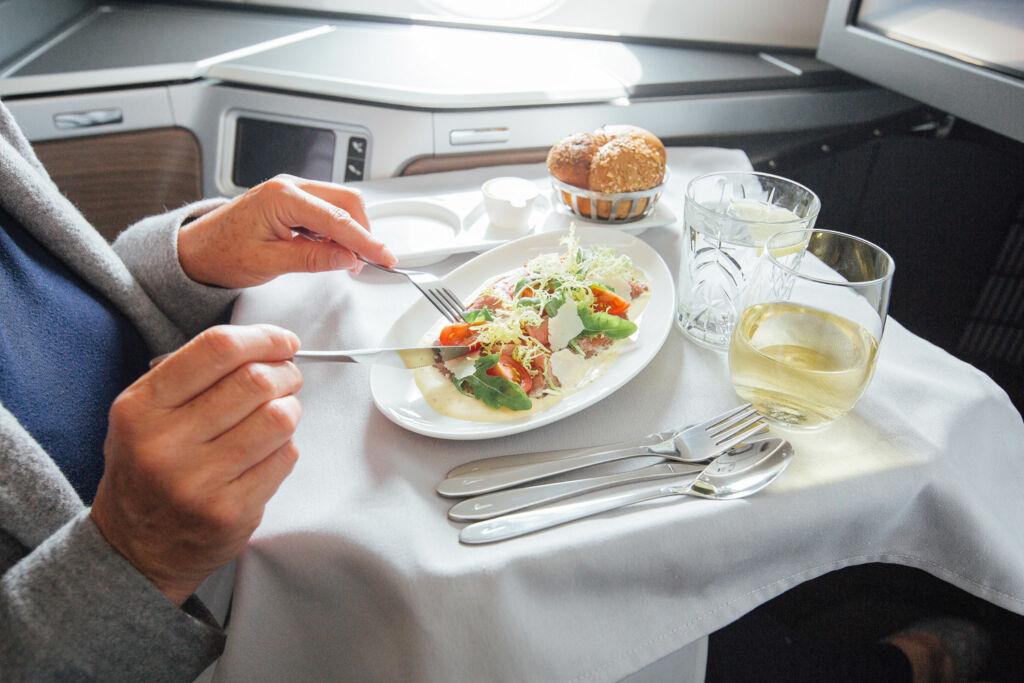 Man enjoying some fine dining in British Airways First