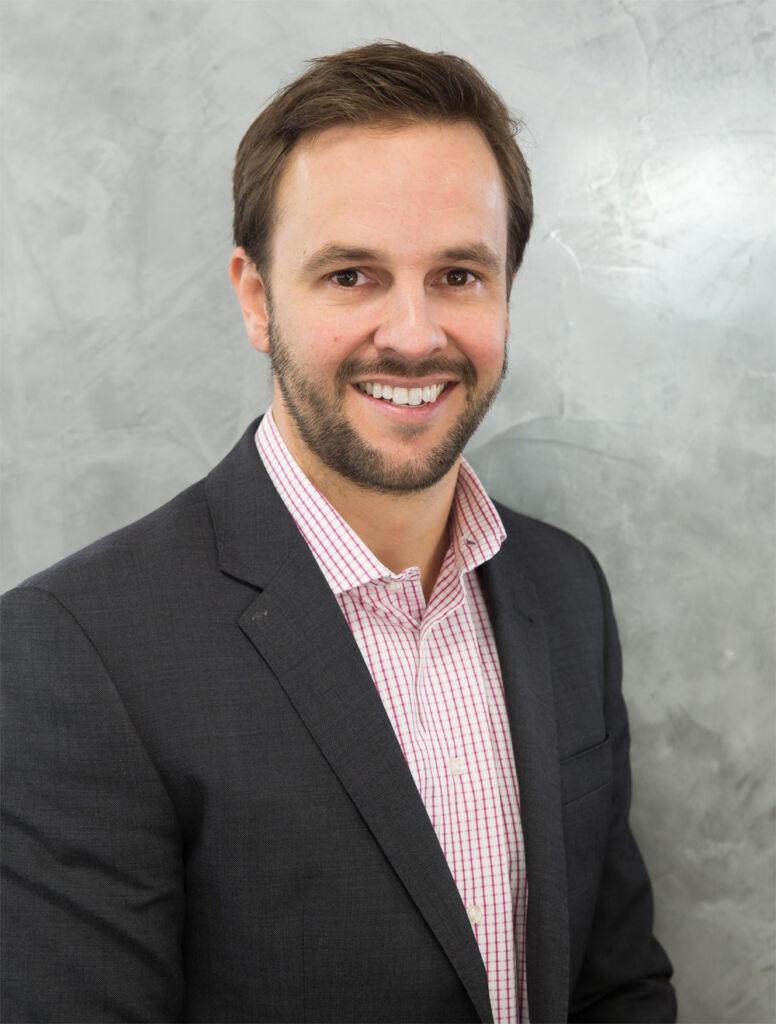 Scott Bozinis, the CEO of InfoTrack UK