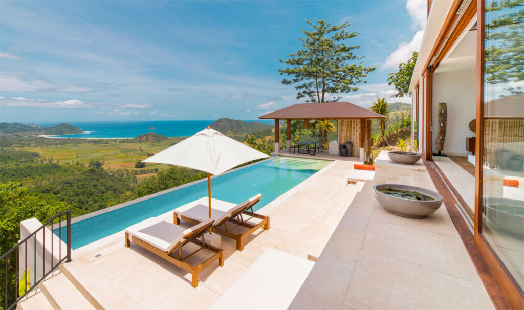 Outside one of the villas showing an infinity pool looking out over the sea