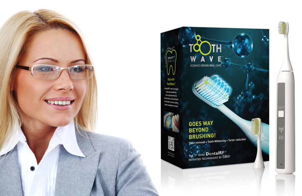 Silk'n ToothWave and toothbrush heads next to its packaging