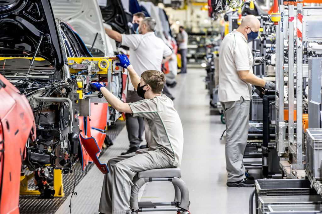 People working on the production line in 2021