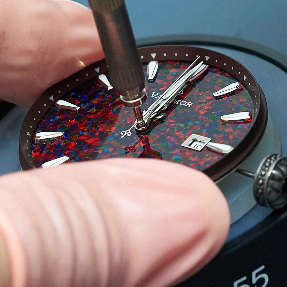 One of the company's artisans putting watch hands onto the Caliburnis II dial
