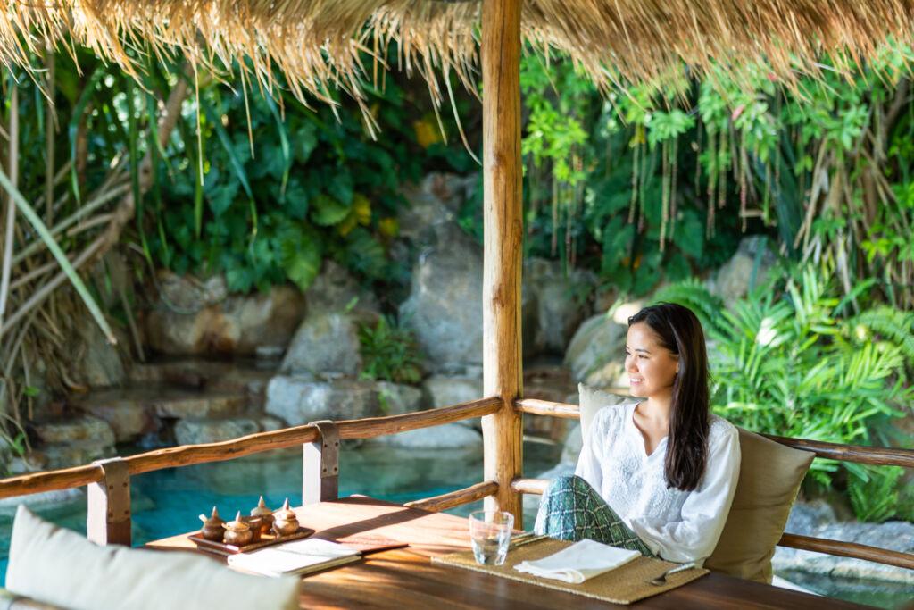 Woman relaxing in the wellness resort's Amrita Restaurant