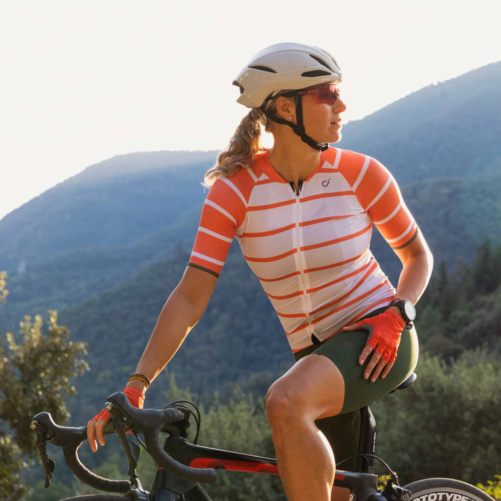 Woman riding a bike in the mountains wearing Velocio