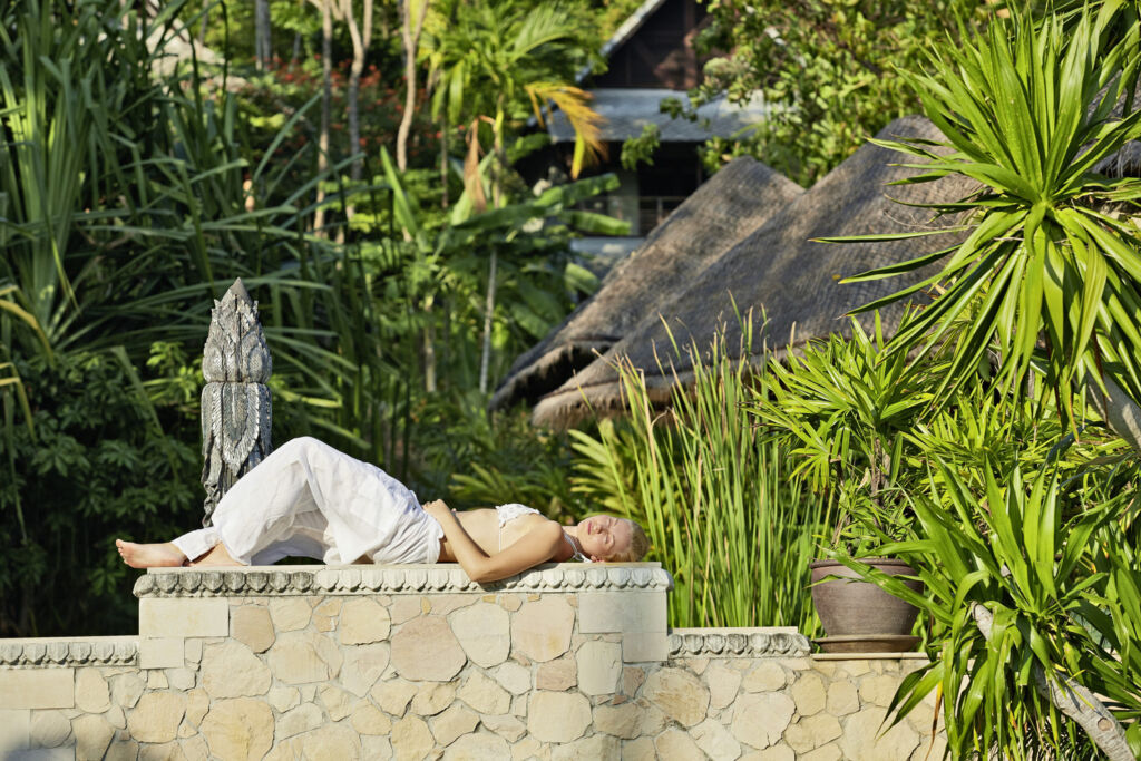 A woman taking a nap at in the relaxed surroundings. Photo by Thomas Zerlauth