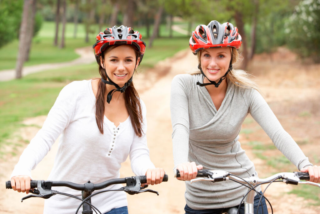 Two women cycling in the countryside