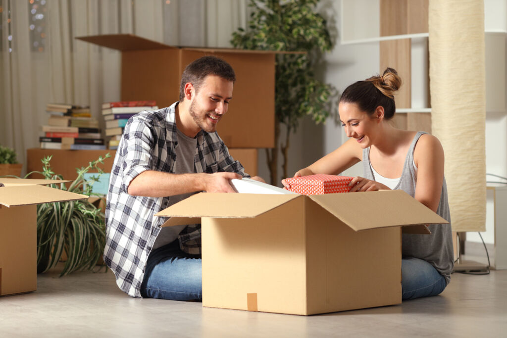 Young homeowners unpacking following a house move