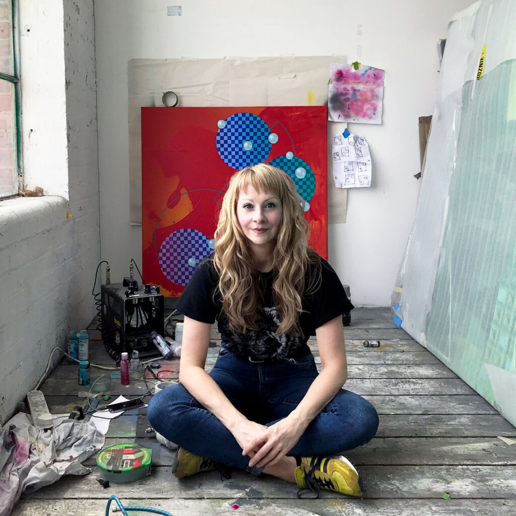 Charley Peters sat on the floor in her studio