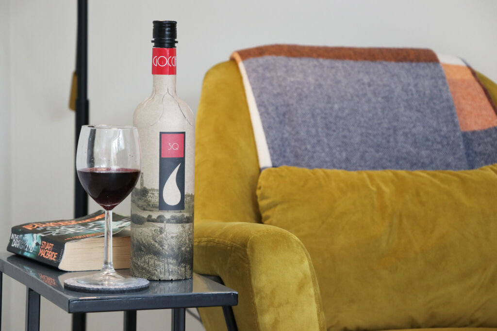 A bottle of the wine being enjoyed in a hotel room