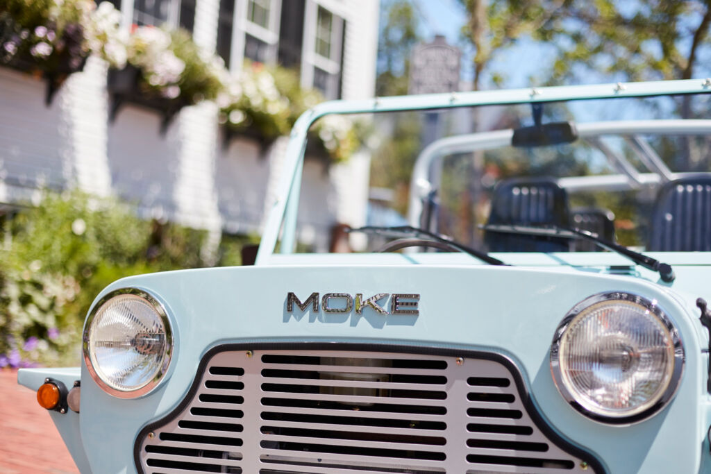 The front of the vehicle proudly displaying the MOKE badge