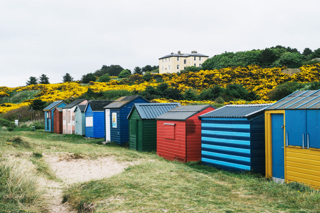 Colourful beach huts in Speyside