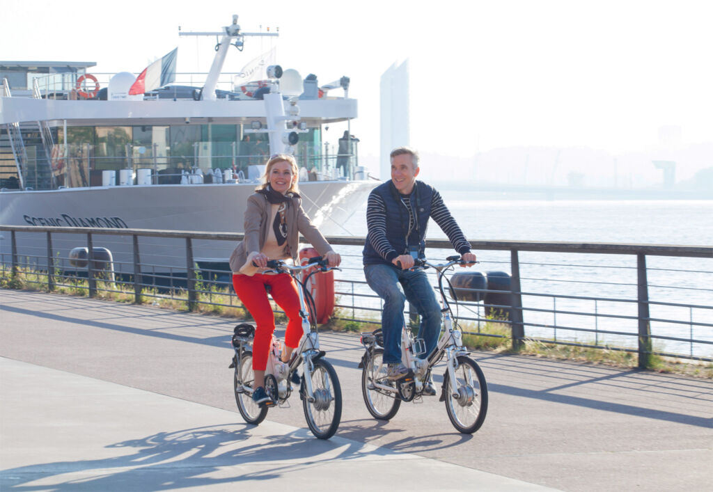 Couple enjoying a bicycle ride by the river