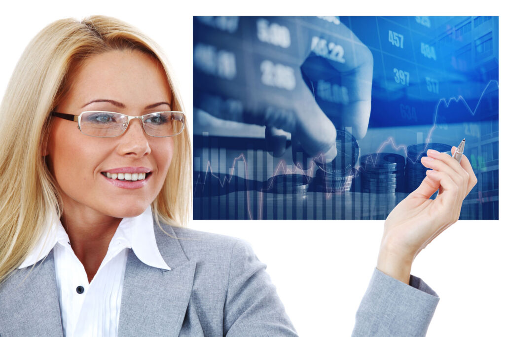 Woman standing in front of a screen showing stock prices