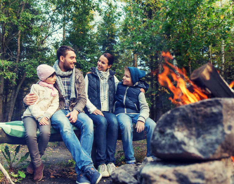 A family enjoying some Eco-Camping by a fire