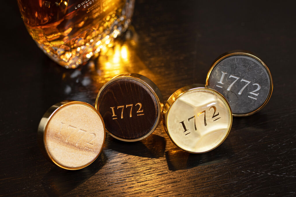 The Littlemill Testament Whisky decanter stoppers proudly engarved with 1772 on their tops