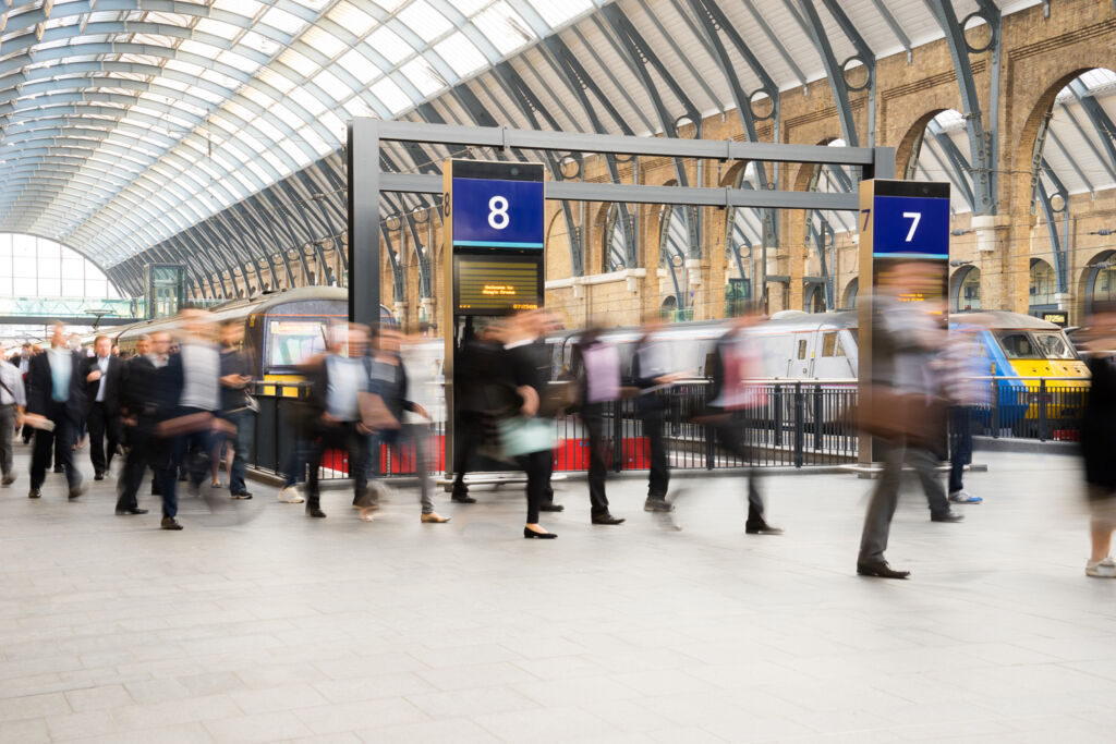 Busy commuters heading to work at a London overground train station