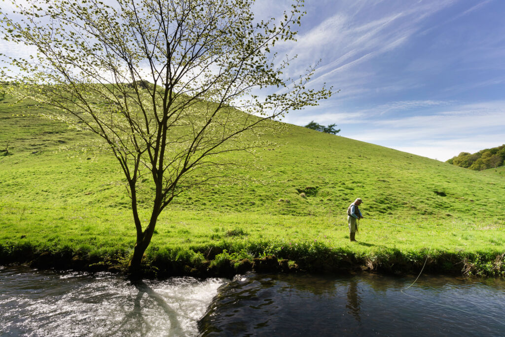 A man fishing in one of the many rivers in the Peak District