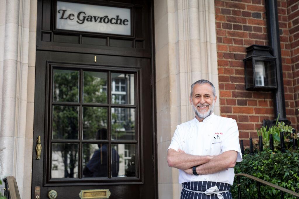 Michel standing outside Le Gavroche