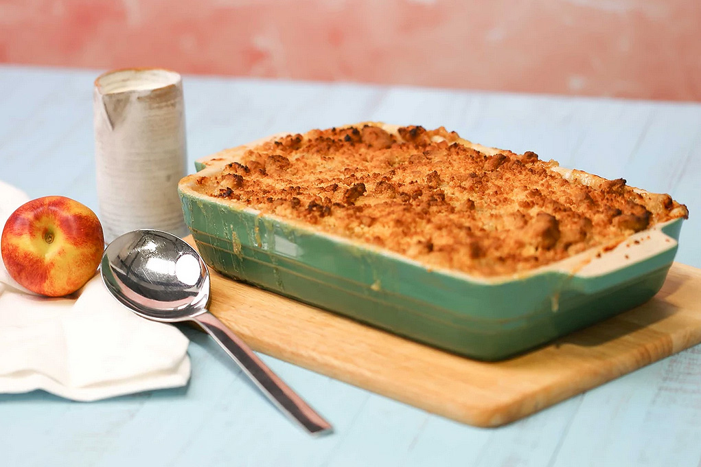 The cooked apple crumble proudly displayed on the dining room table