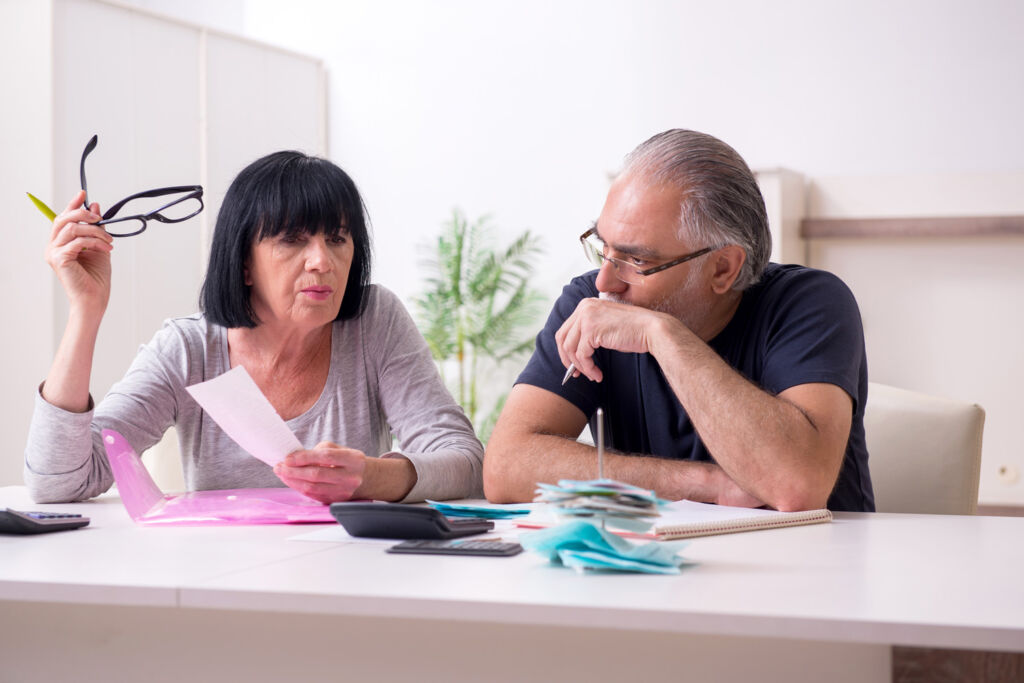 An older couple looking into their finances