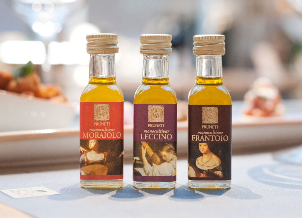 Three varieties of Pruneti extra virgin olive oil in bottles