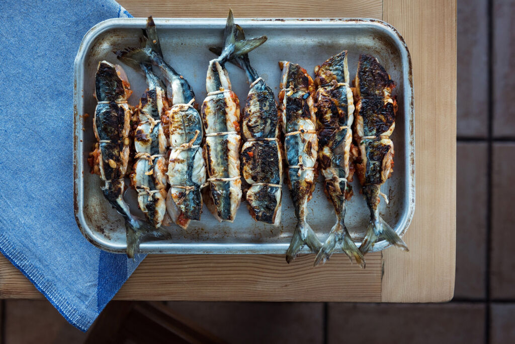 Freshly cooked mackerel in a tin tray