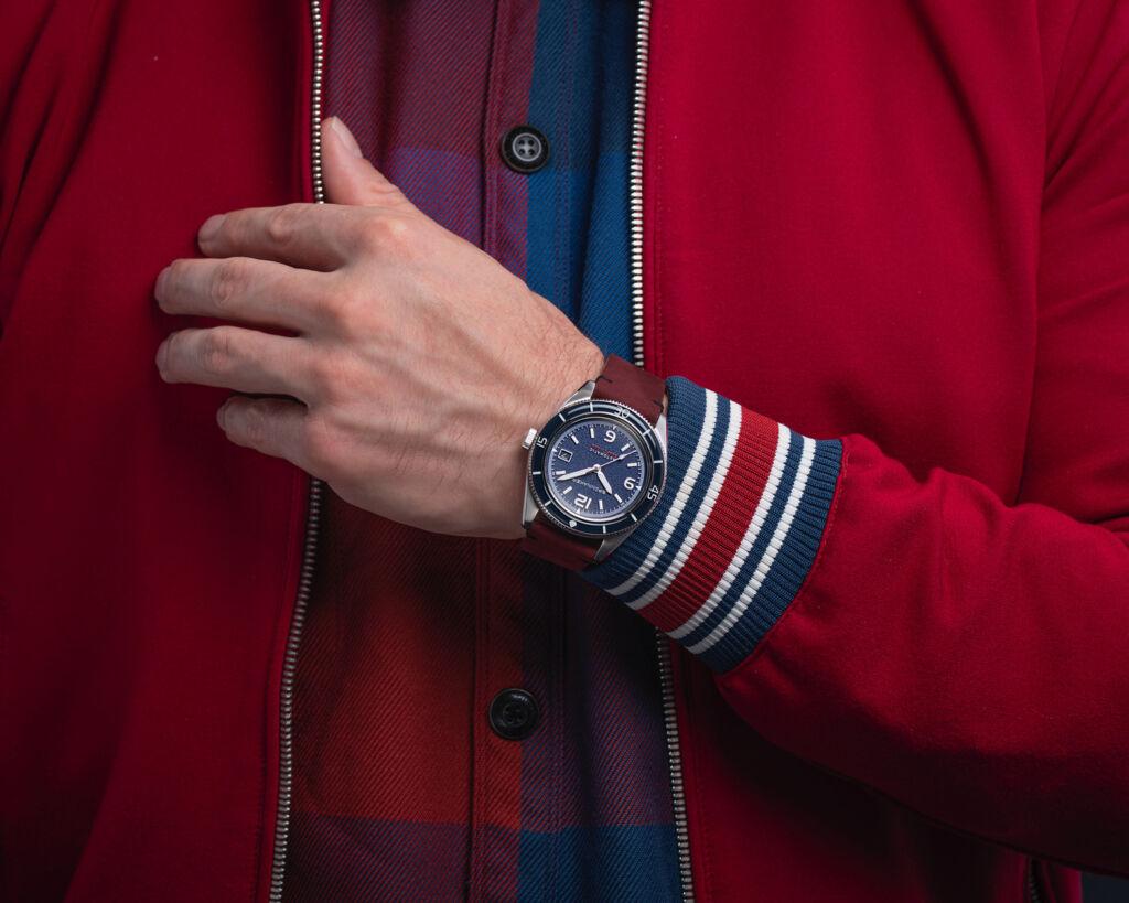 The Prussian Blue version bing worn on a mans wrist