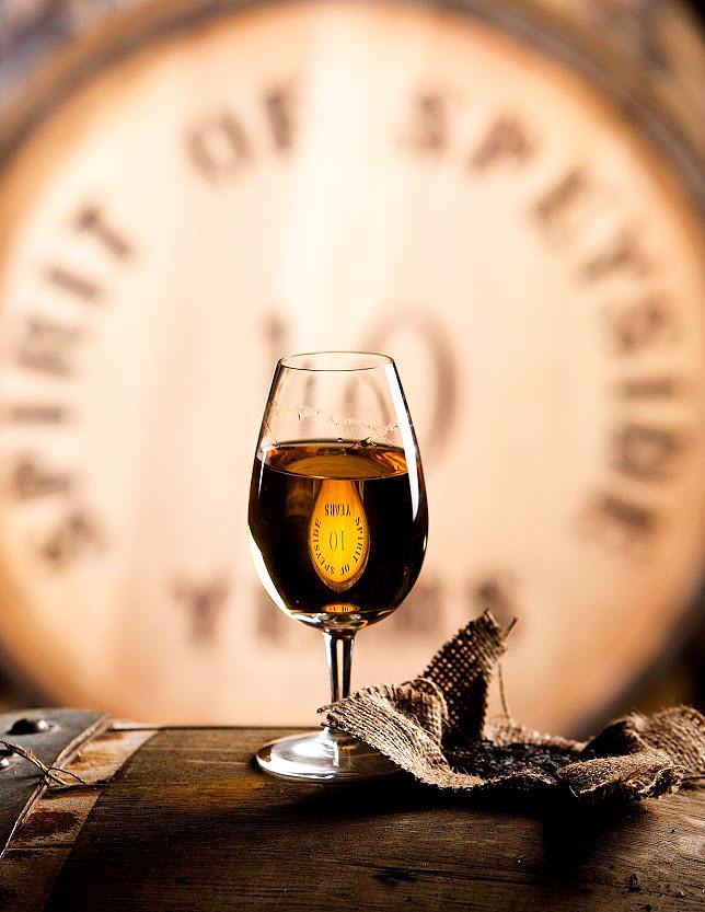 A glass of Speyside whisky on a barrel