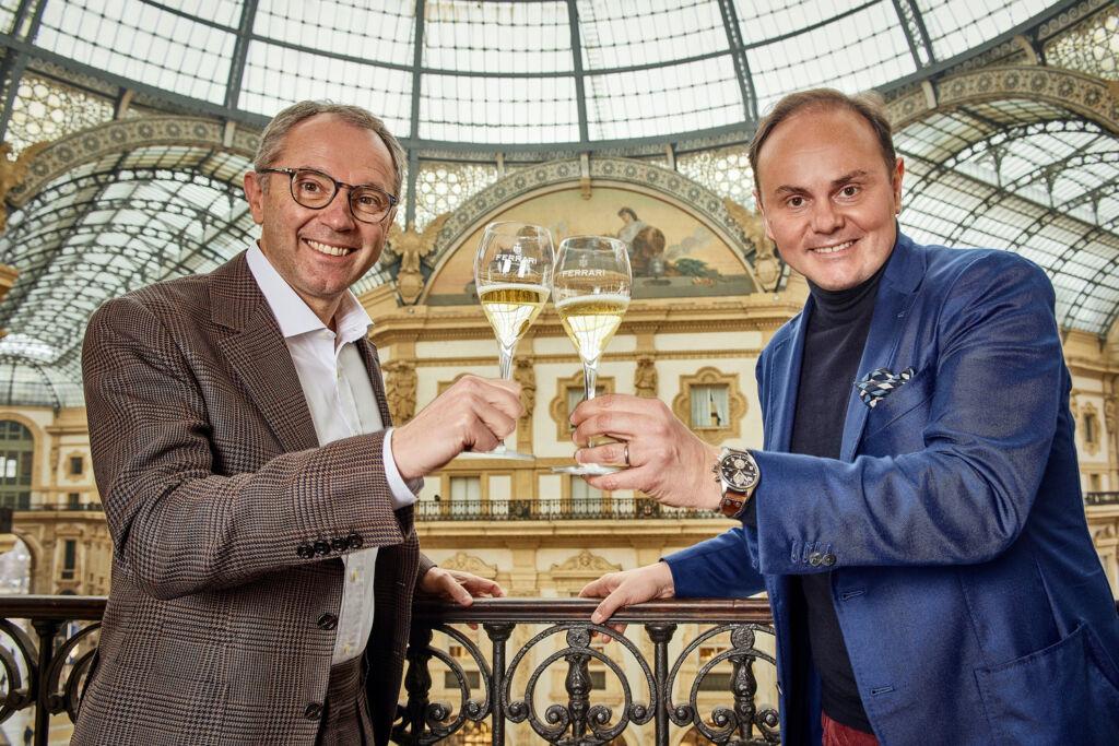 Stefano Domenicali and Matteo Lunelli making a toast with Ferrari Trento