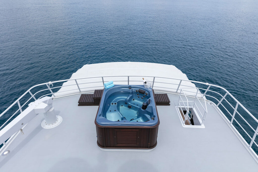 The yacht has an outdoor Jacuzzi where you can relax and enjoy the views