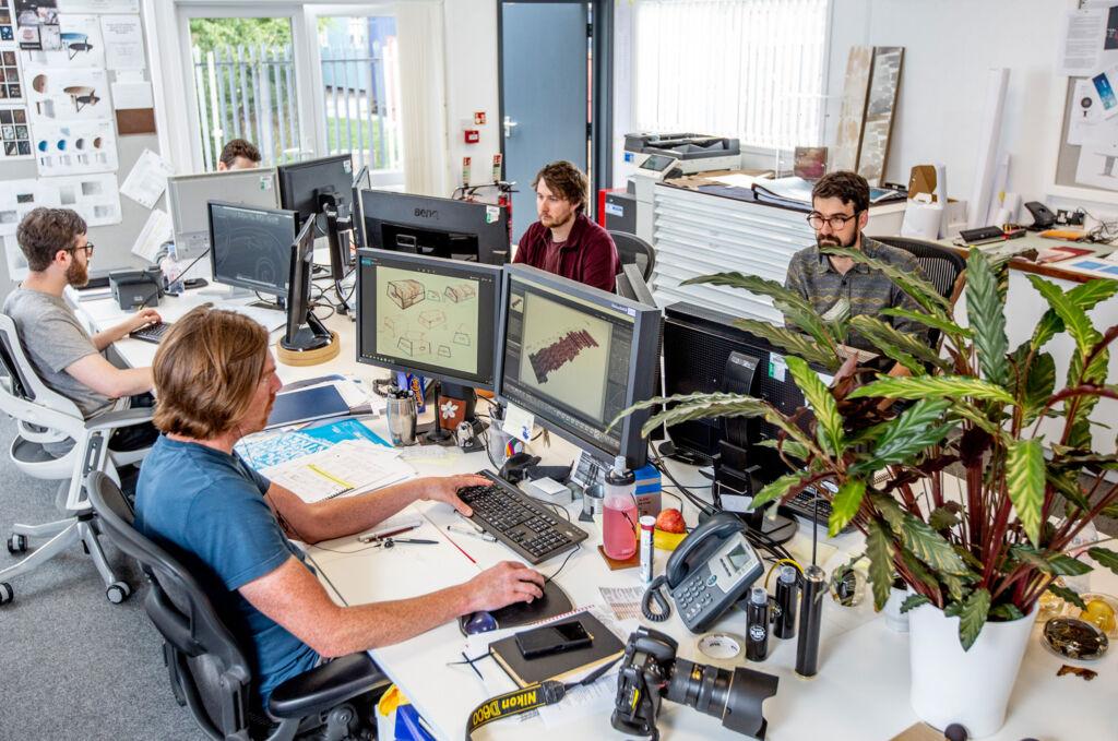 The design team hard at work behind their screens