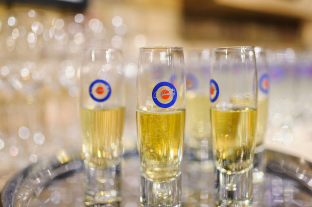 The beautiful champagne glasses with the iconic Bullseye logo on the front