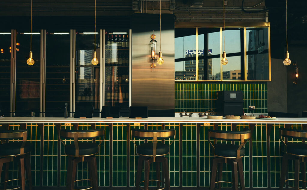 A view of the green and gold tiled bar