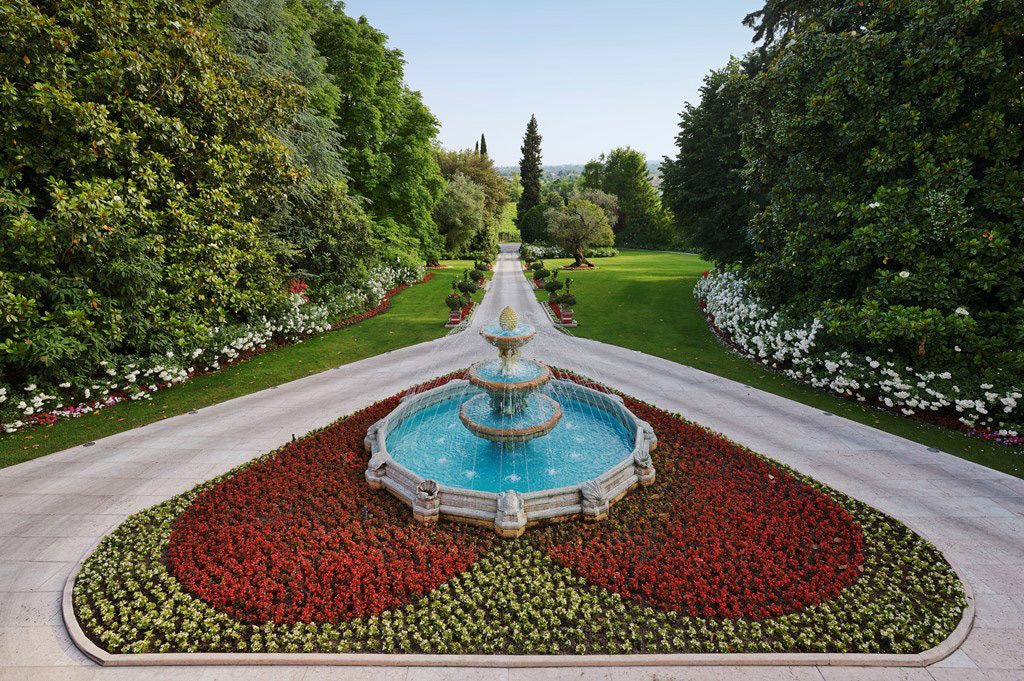 The beautiful marble fountain set in a heart shaped flower bed