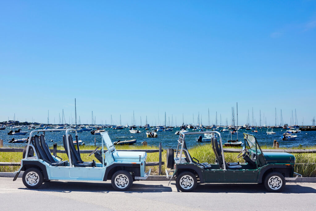 Two of the vehicles parked side by side in an English Harbour