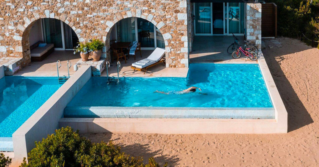 Someone swimming at their private pool at their villa