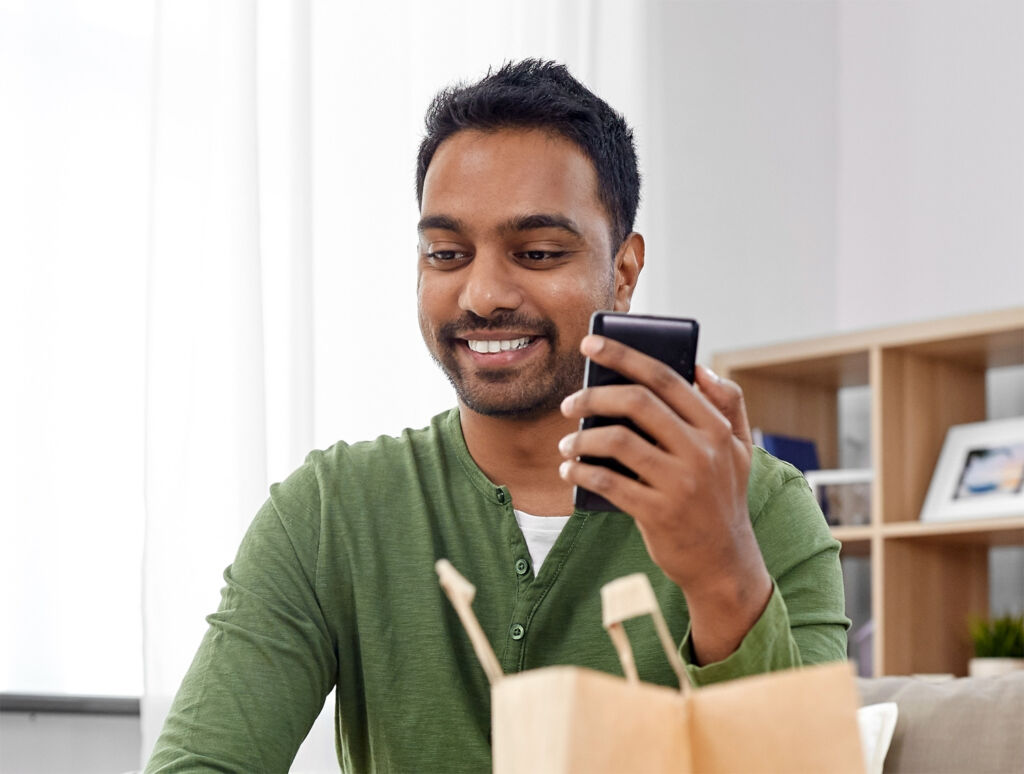 Young man ordering online from his phone