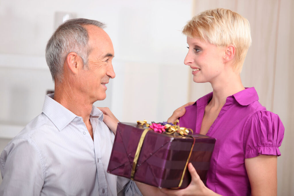 A daughter giving her dad a gift on Father's Day