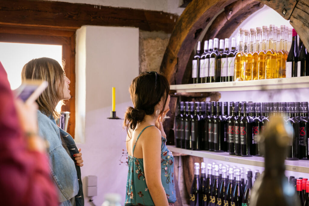 People looking a various fine wines produced in Majorca