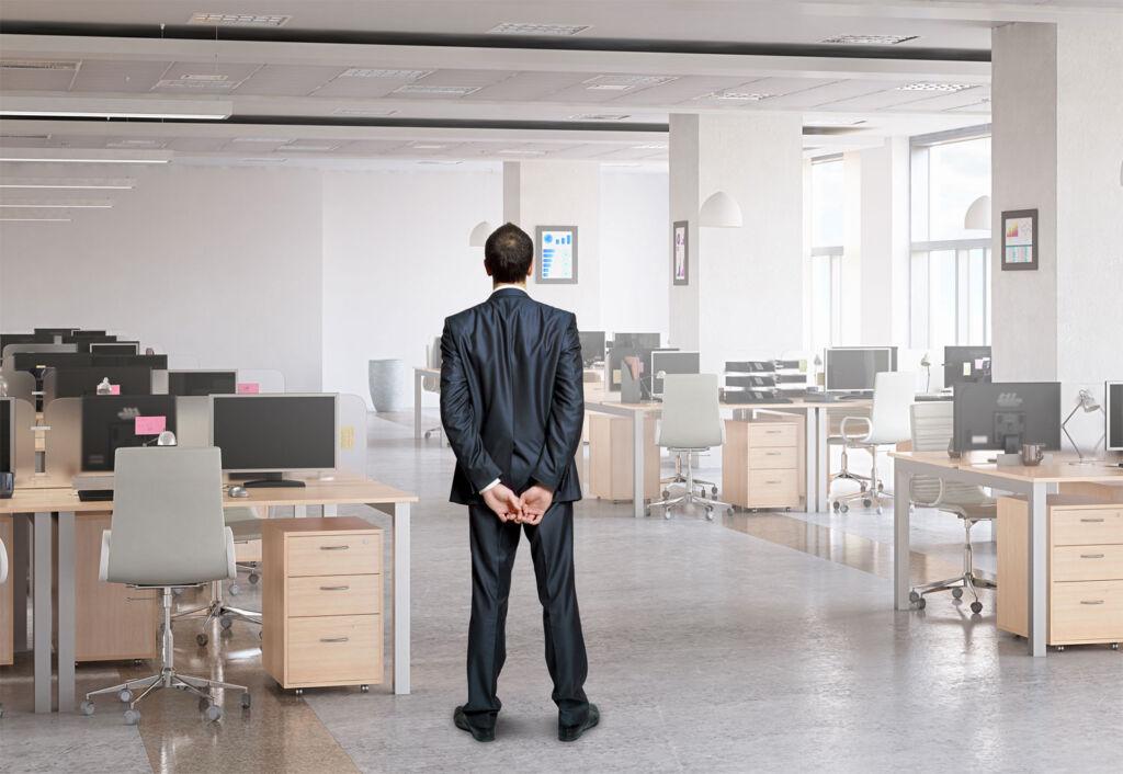 A travel boss standing in an empty office