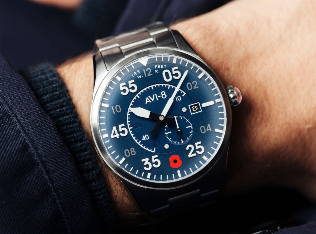 A close up view of the dial while being worn on a wrist