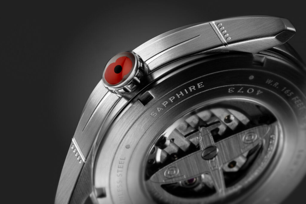 A closeup of the poppy on the crown of the watch