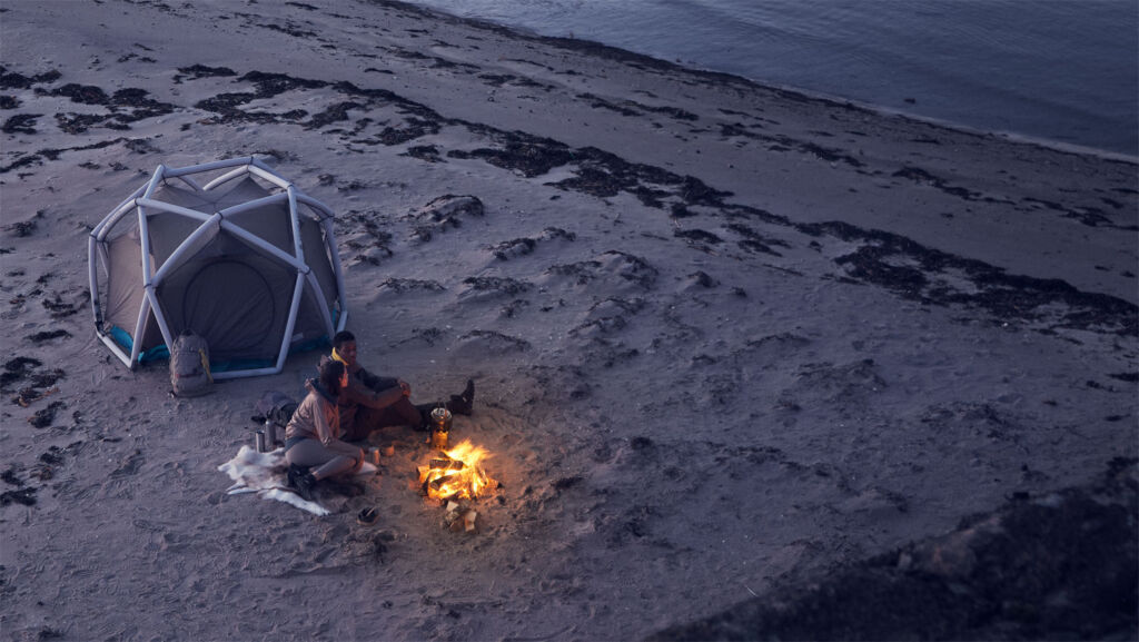 Couple camping in a tent by the sea
