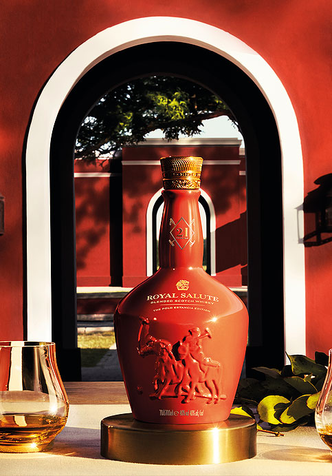 Bottle of the 21 Year Old Polo Estancia Edition with an arched entrance bedhing it