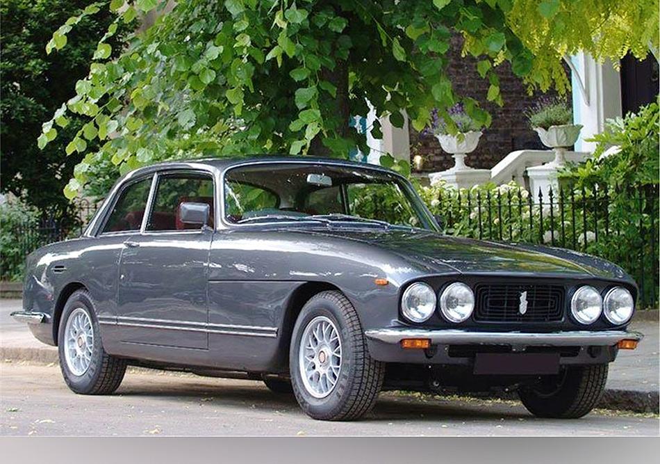 A Bristol 411 in grey parked in a leafy street