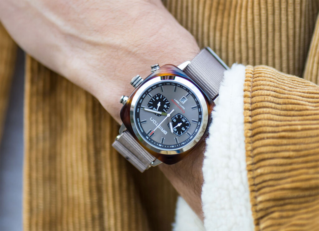 The Clubmaster Sport in the grey taupe colour scheme being worn on the wrist