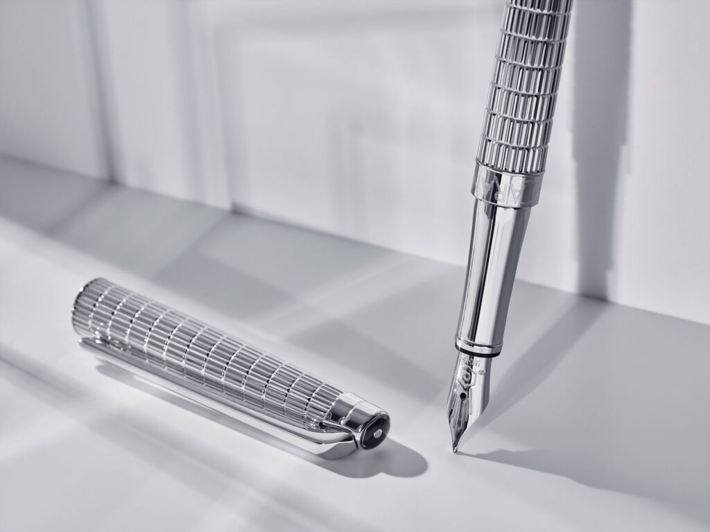 A closeup view of the intricate engraving on the body of the Léman Slim Lights fountain pen