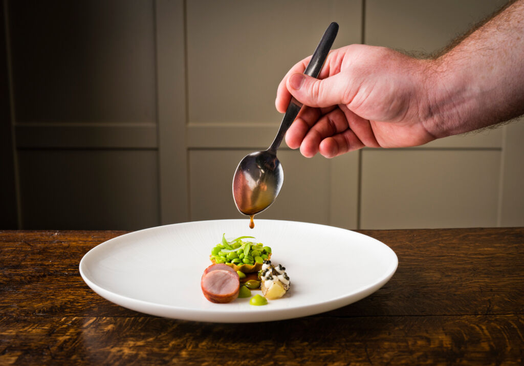Dan plating one of his dishes at Rothay Manor